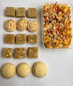 Pictures of Indian Gujarati Snacks Coconut Pin Wheels, Magaj, Methi, Chevdo, Gundar Pak